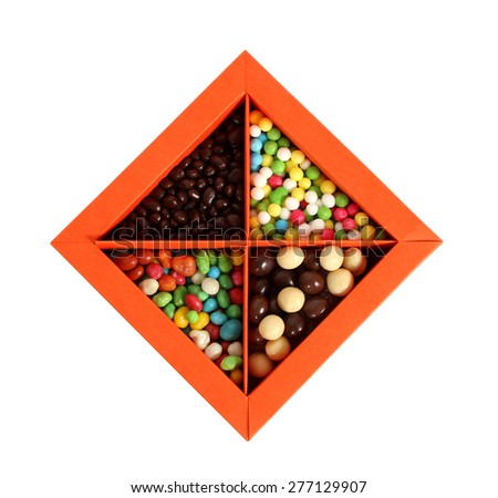 Single orange box full with candy on white background, cut out