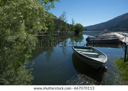 Single Rowboat In A Marina