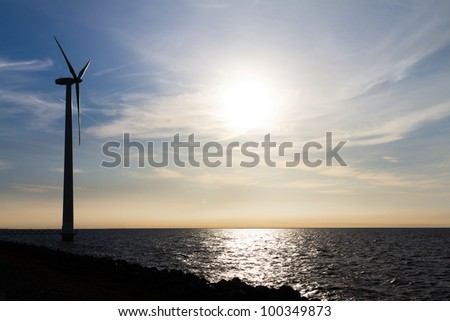 Single windmill at the water
