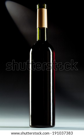 Single wine bottle over dark background