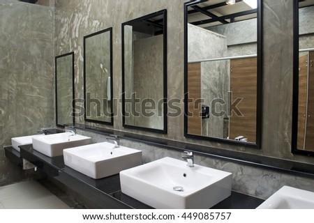 Bathroom minimalist style commercial bathroom stock photo for Public bathroom sink