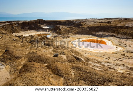 Sinkhole or open pit on the shore's of the dead sea at the end of the summer when the water level is at it's lowest