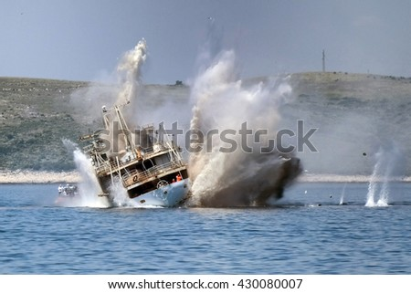 Sinking old navy ship with explosion