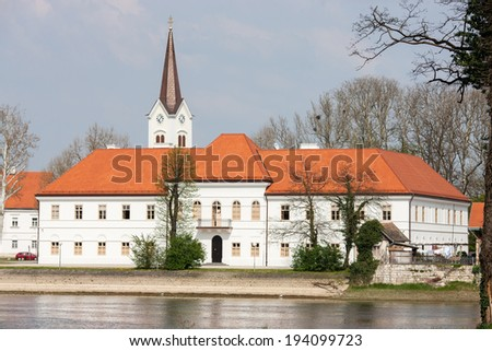 SISAK, CROATIA - April 13, 2013 - View of Sisak city theater and Cathedral of Exaltation of the Holy Cross.