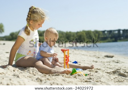 Sister & Brother are playing on the beach