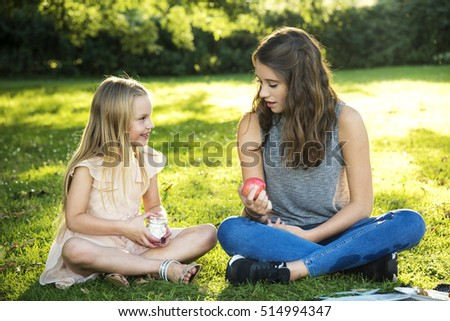 Sister Girls Talk Picnic Togetherness Outdoors Concept