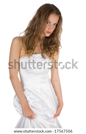 sitting beauty bride in white dress over white