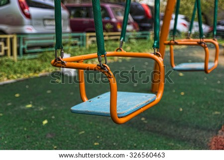 sitting of a children's swing in the autumn yard