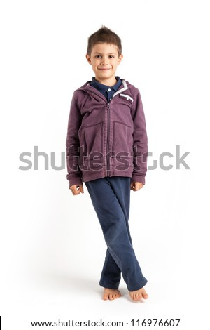 Six year kid, against white background. Full body portrait.