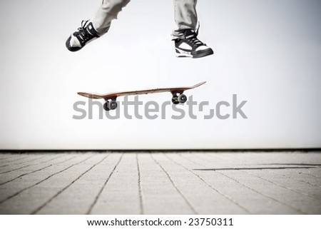 skater making an olli with his skateboard