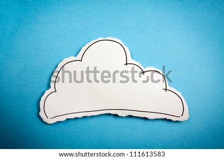 Sketch made by a child, little Cloud draw on a cut out white piece of paper shot on a bright cyan background