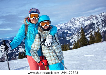 Two boys sledding mountain warm winter stock photo for Warm winter family vacations