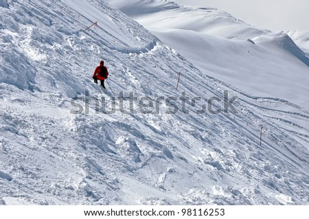 Skier going down the mountain on a slope in a sunny day. Kitzsteinhorn, Austria