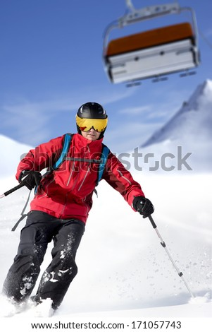 Skier is skiing under the gondola