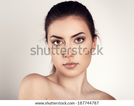 Skin facial care. Young attractive Caucasian woman  posing in studio.