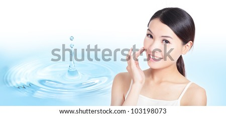 Skincare woman hand touch face with smile , water drop background, concept for cosmetic, beauty hygiene, makeup, moisturize, model is a asian beauty