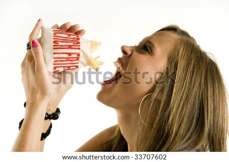 Skinny girl eating french fries