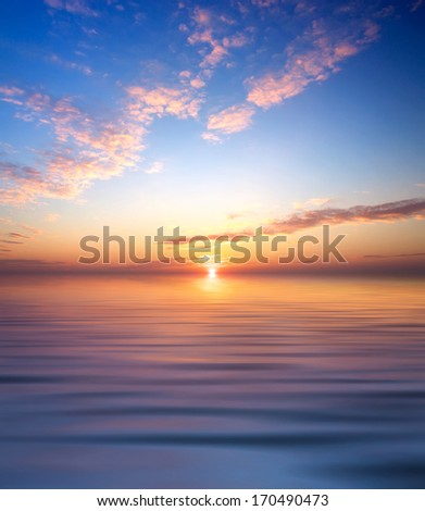 Sky and reflection in the water. Beautiful abstract seascape