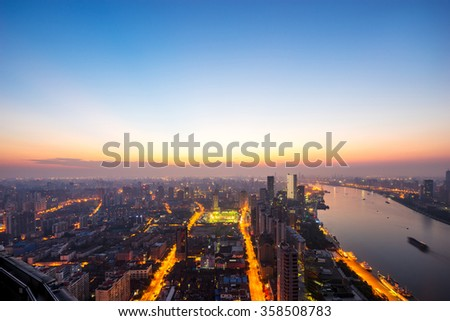 skyline and cityscape of riverside modern city at sunset