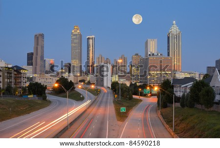 Skyline of downtown Atlanta, Georgia from above Freedom Parkway with a full moon.