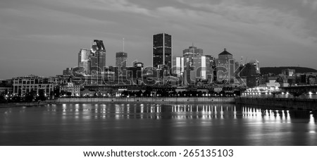 Skyline of downtown Montreal, behind the St Lawrence River,view from the Pierre-Dupuy Street at dusk.