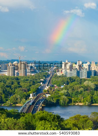 Skyline of Kiev with Metro bridge and rainbow in the sky. Ukraine