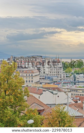 Skyline of Lausanne, Switzerland as seen from the Cathedral hill. Lake Leman (Lake Geneva) and the French Alps provide a beautiful background.