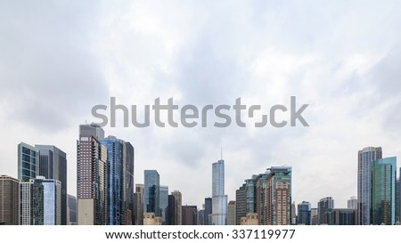 Skyscrapers against the cloudy sky in Chicago, IL, USA.