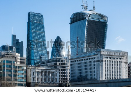 Skyscrapers of The City in London at sunrise in 2014. Buildings include 122 Leadenhall Street (aka the Cheesegrater), 30 St Mary Axe (aka The Gerkin) and 20 Fenchurch Street (aka The Walkie-Talkie)