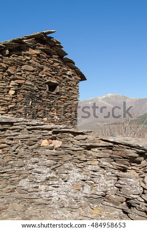 Slate house in one of the Black Villages Guadalajara (Spain), with the Ocejon Peak in the background