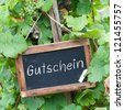 Slate with german text: Gift certificate - stock photo