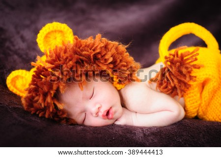 Sleeping newborn baby with Lion suit