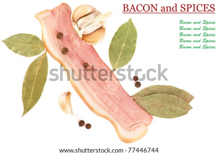 Slice of tasty pork bacon and spices isolated on white background