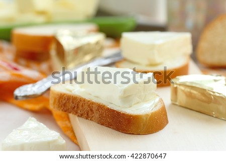 Sliced bread with cream cheese and butter for breakfast