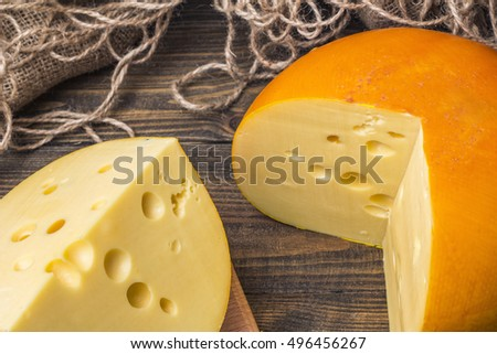 sliced cheese on a wooden table top view