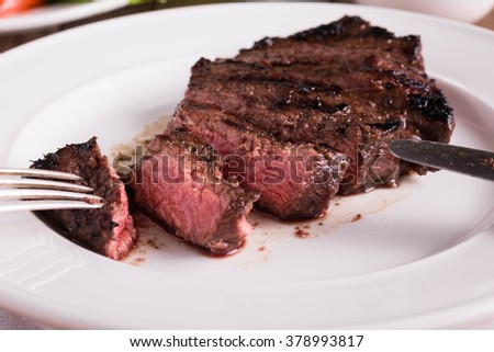 Sliced medium rare Grilled Beef Steak. Selective Focus.