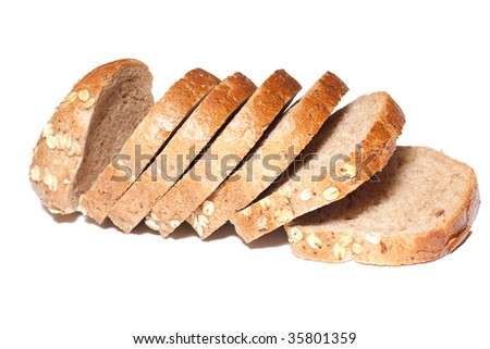 Sliced of whole grain bread isolated on white.