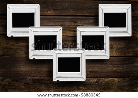 sliding seats for pictures on a wooden background