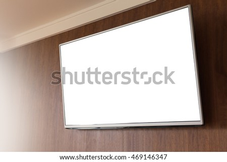 Slim TV blank holding on wood wall background.