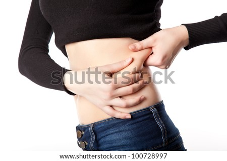 Slim woman is on a diet. Isolated on a white background