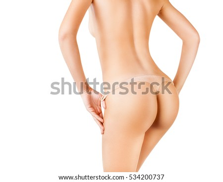 Slim woman's body. Close up of buttocks in a thong, isolated on white background