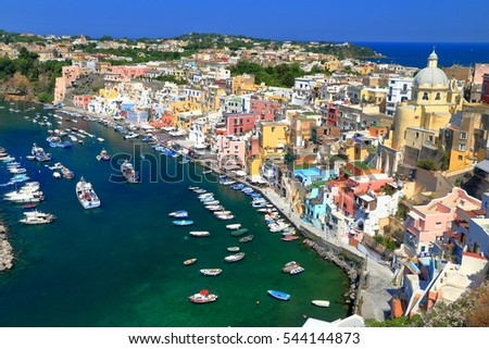 Small boats anchored inside Marina Corricella on the island of Procida, bay of Naples, southern Italy