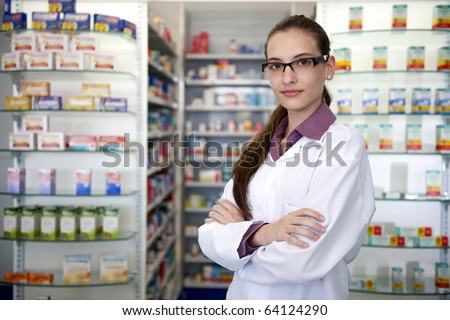 small business owner: portrait of a female pharmacist at pharmacy