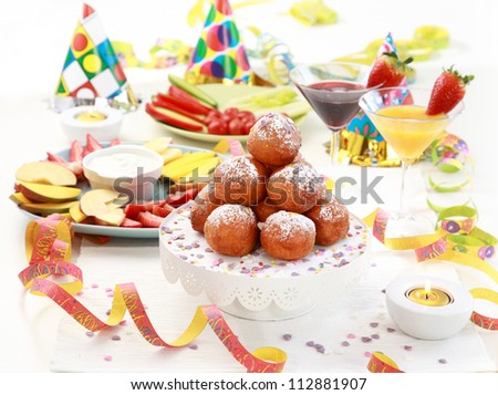 Small fried doughnut with cocktails for carnival