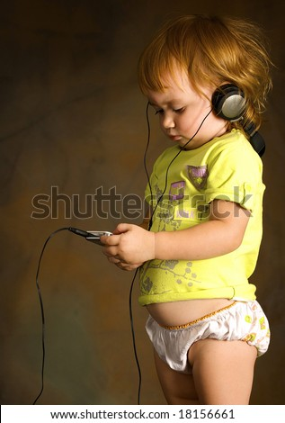 Small girl listens to the music