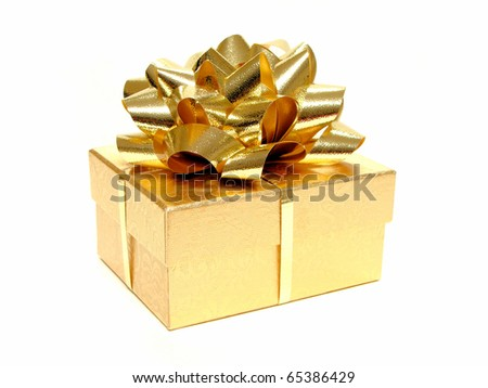 Small gold gift box with bow and ribbon on a white background