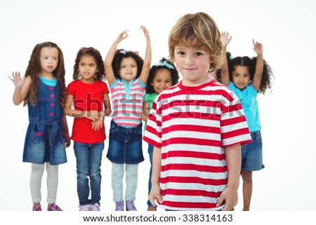 Small group of kids standing together against a white background
