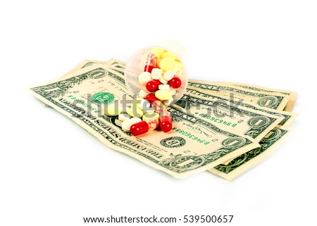 small heap of paper dollars and medical drugs