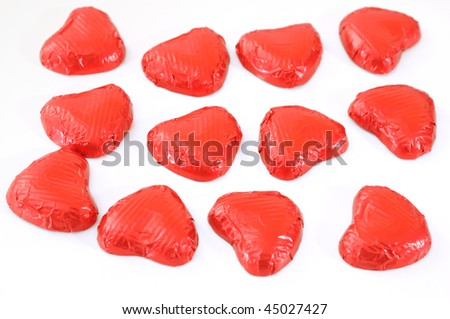Small heart-shaped chocolates with white background, ideal for your valentine's design