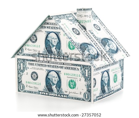 Small house from banknotes on a white background
